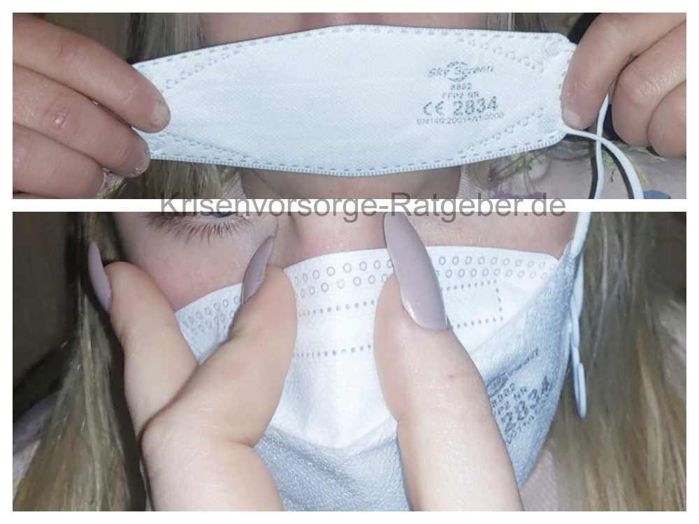 FFP 2 Maske für Kinder aufsetzen - Unterstützung durch Erwachsene